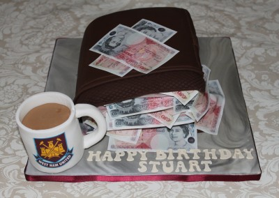 Wallet with edible money cake.