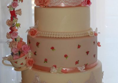Wedding Cakes - 4 tier pouring teapot wedding cake with sugar flowers and hand painted details.