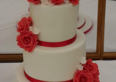 Wedding Cakes - 3 tiered wedding cake, handmade sugar roses and sugar bride and groom.