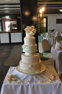 5 tier shades of spring wedding cake