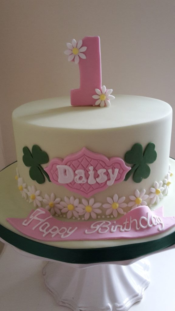 Daisy first birthday cake - bespoke design with flowers and clovers