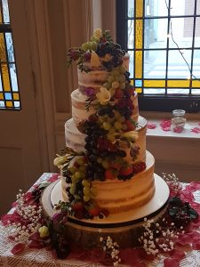 Semi-naked wedding with fruit and fresh flowers