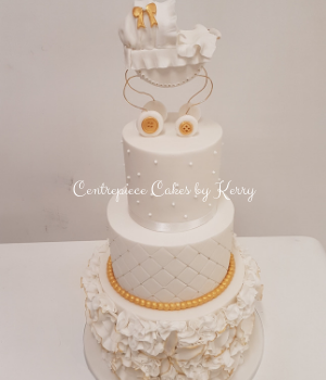 3 tier white and gold baby shower cake with pram topper