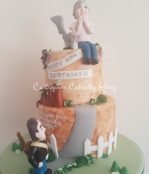 80th birthday cake with modelled figures