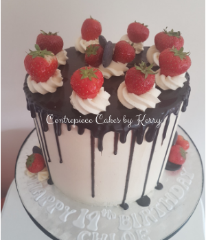 Buttercream and strawberries drip cake