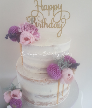Semi naked drip birthday cake with edible fresh flowers