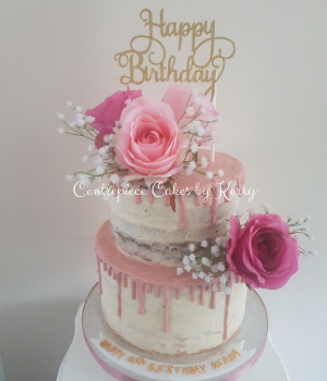 Semi naked drip birthday cake with faux flowers