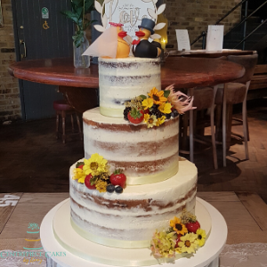 Whimsical semi naked wedding cake